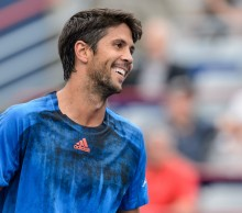 MONTREAL, ON - AUGUST 11:  Fernando Verdasco of Spain smiles at his opponent Nick Kyrgios of Australia during day two of the Rogers Cup at Uniprix Stadium on August 11, 2015 in Montreal, Quebec, Canada.  (Photo by Minas Panagiotakis/Getty Images)