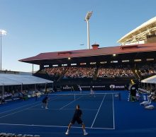Doubles action at World Tennis Challenge